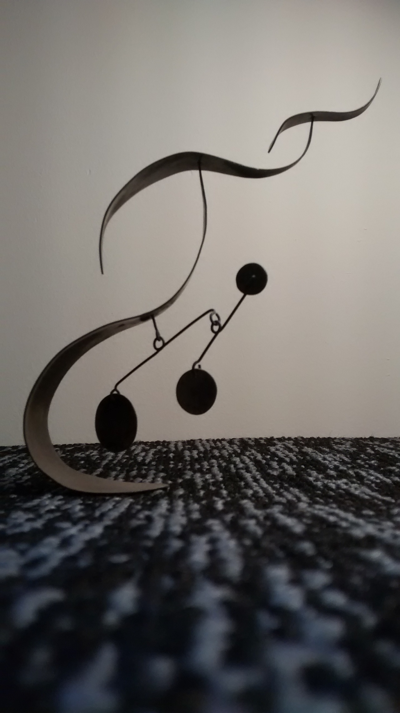 Standing spinning brass Sshapes